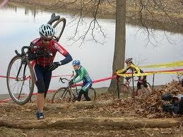 Cyclocross racer, Catherine Johnson, carries her bike uphill