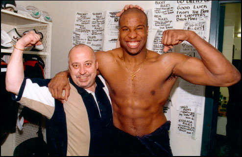 Canadian National Hockey League player, Georges Laraque, poses next to a fan