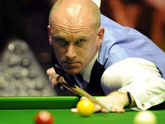 Peter Ebdon readies his pool cue to make a shot