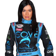 Leilani Munter looks at the camera, dressed in full driving attire